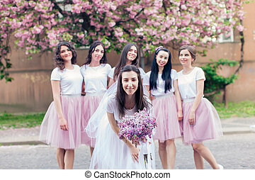 Bride-to-be holding flowers - Funny portrait of bride at hen...