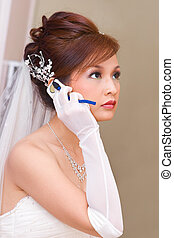 Bride to be talking on cell phone - A bride to be is calling...