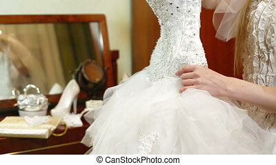 Bride Trying On A Wedding Dress
