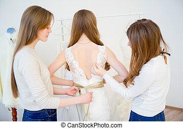Bride trying on wedding dress
