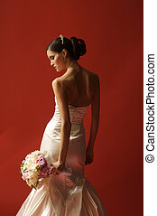 Bride Turned Toward Red Wall Looking Down - Image of a bride...