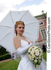 Bride under parasol