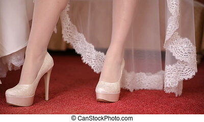 Bride walking shoes in the room