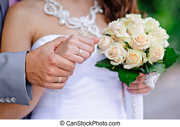 Bride walking with groom in the hands of a beautiful wedding bou