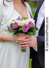 Bride walking with groom in the hands of a beautiful wedding bouquet