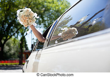 Bride waving hand holding bouquet - Bride waving hand from...