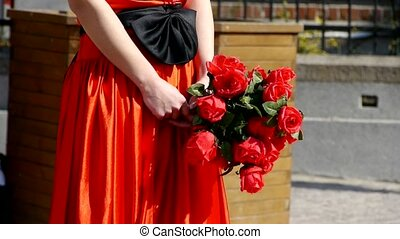 Bride wearing a red wedding dress, c