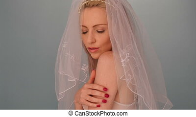Bride wearing bra and veil