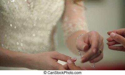 Bride wearing bracelet - Bride wearing jewelry bracelet on...