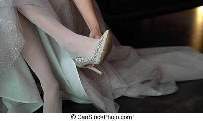 Bride wearing bridal shoes. Morning wedding preparation