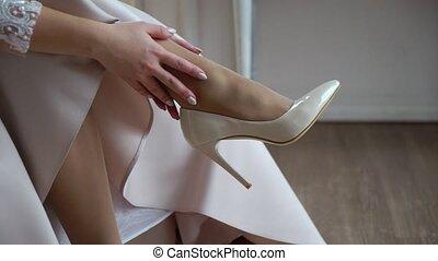 Bride wearing bridal shoes