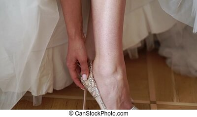 Bride wearing bridal wedding shoes