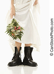 Bride wearing combat boots. - Caucasian bride holding...