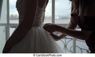 Bride wearing wedding dress - Bride wearing wedding bridal...