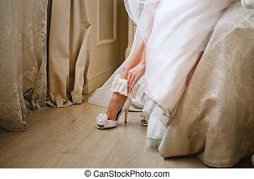 Bride wearing wedding garter