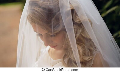 Bride Wears A Veil At Face Close Up shot in slow motion