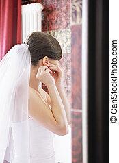 Bride wears earring