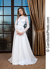 Bride - Wedding dress. Young bride tries on a wedding dress...