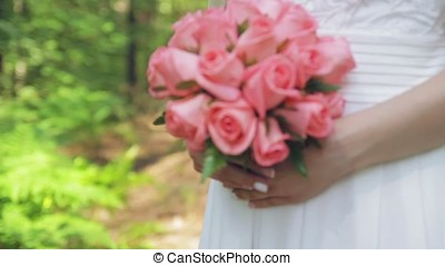 bride with a bouquet in hand