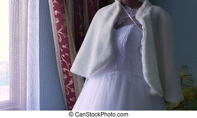 bride with a fur coat in the window on a mannequin Wedding...