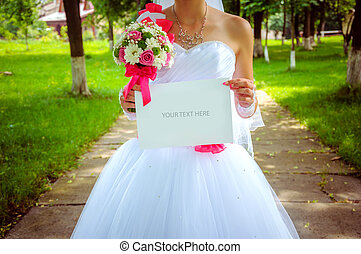 bride with a sign. Wedding background