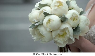 Bride with bouquet of peonies - Bride with bouquet of white...