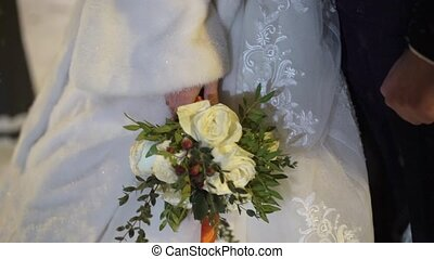 Bride with bouquet outdoors at winter