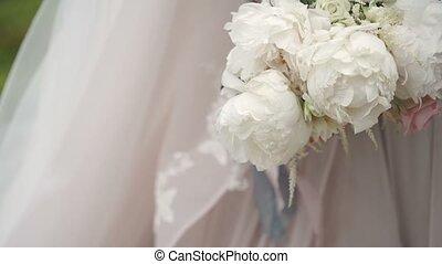 Bride with bouquet unrecognizable slowmotion