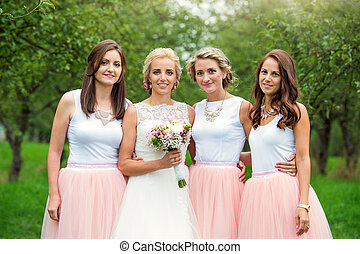 Bride with bridesmaids - Beautiful young bride with her...