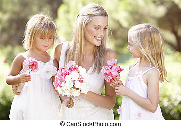 Bride With Bridesmaids Outdoors At Wedding