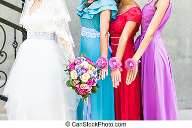 Bride with bridesmaids outdoors on the wedding day