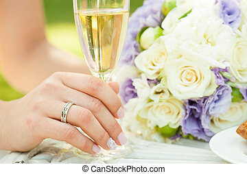 Bride with champagne and flowers