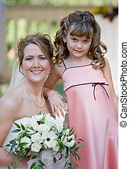 Bride With Flower Girl - Beautiful Bride Posing With Her...