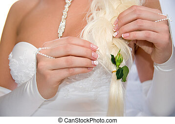 Bride with flower unblown roses in her hair