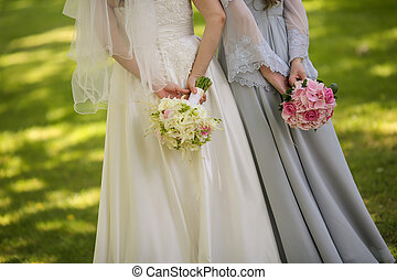 Bride with flowers and maids of honor