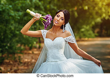 bride with flowers , happy bride on the wedding photography