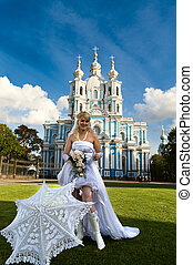 Bride with flowers in white dress