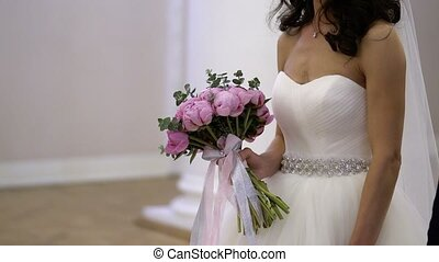 Bride with flowers on ceremony