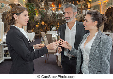 bride with friends drink champagne during preparation