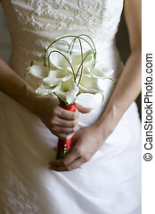 bride with lily bouquet