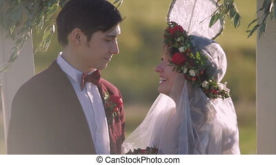 Bride With Tenderness Looks at The Groom
