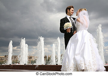 bride with the fiance against the background of the fountains