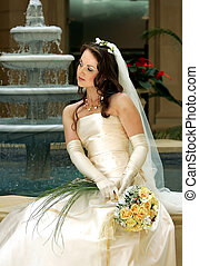 Bride with veil holding bouquet
