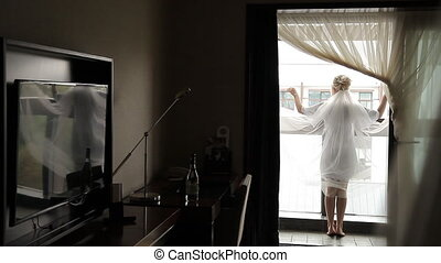 bride with veil on the balcony - bride with veil on the...