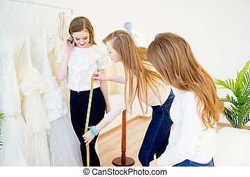 Bride with wedding assistant