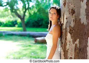 bride woman happy posing in outdoor tree