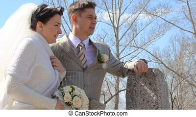 bridegroom and bride stands arm-in-arm - bridegroom and...