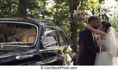 Bridegroom hugs and kisses his wife - Lucky bridegroom hugs...