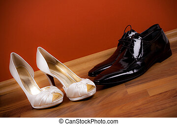 Bride\'s and groom\'s shoes on the floor
