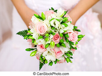 Bride holding orchid vivid flowers bouquet in hands